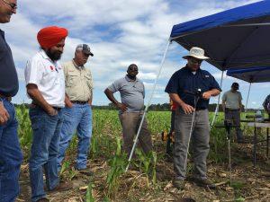Bhupinder Farmaha and Gordon Mickel teach soil health assessment techniques.