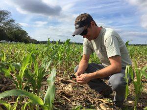 Jason Carter inspects the soil.