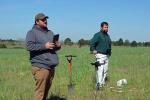 Instructors discuss assesment of various cover crops.