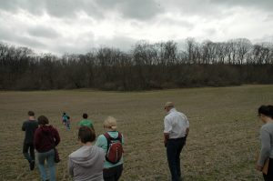 a group of people walking through a field