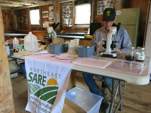 Network volunteers processing samples for Nosema analysis at the Statewide NH Beekeepers summer meeting