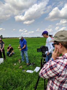 Caiti Sullivan (Future Harvest) films as Jim Brewer (NRCS) demonstrates the Maryland Soil Health card. Photo: Nevin Dawson