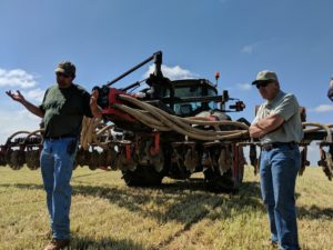 Ed Fry (Fair Hill Farms) stands by as the operator explains the cow manure injection process. Photo: Nevin Dawson