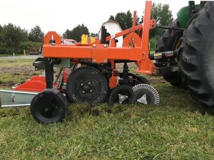 Custom-built powered strip tiller side view.