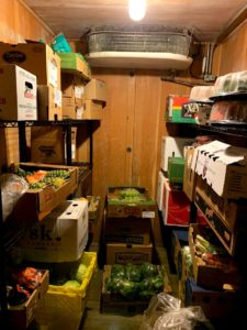 Photograph shows inside of a 1960s walk-in produce cooler.